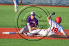 Cortland Crush Josh Reuter (23) tags Syracuse Salt Cats Alexander Ferlenda (18) out at OCC Turf Field in Syracuse, New York on Saturday, July 8, 2017. Cortland won 9-3.