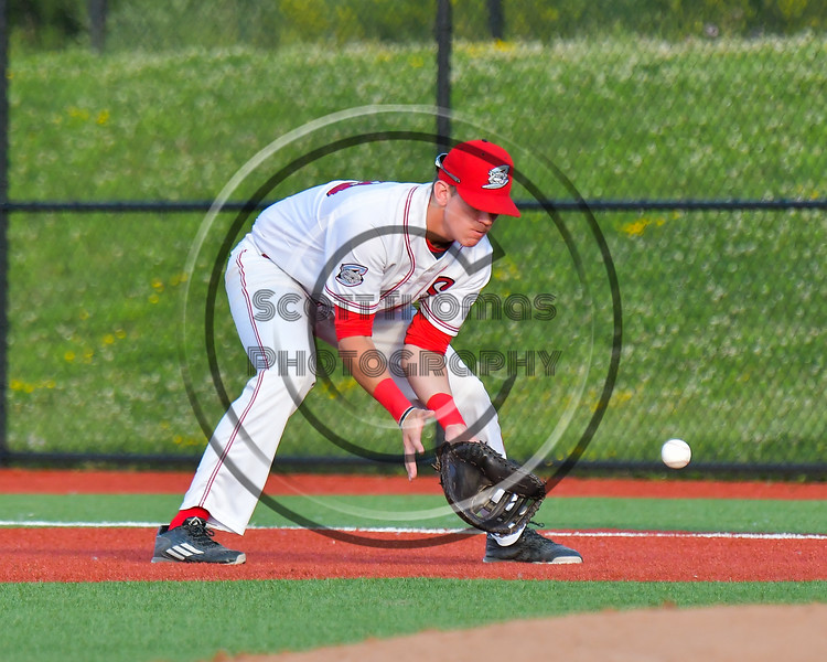 Syracuse Salt Cats First Baseman Justin Clark (29) fielding the ball against the Cortland Crush at OCC Turf Field in Syracuse, New York on Sunday, July 16, 2017. Syracuse won 9-4.
