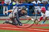Cortland Crush TJ Wegmann (10) fielding the ball as a Syracuse Salt Cats player slides into Home Plate at OCC Turf Field in Syracuse, New York on Sunday, July 16, 2017. Syracuse won 9-4.