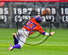Cortland Crush Josh Reuter (23) dives for the ball against the Wellsville Nitros at Wallace Field on the SUNY Cortland campus in Cortland, New York on Friday, July 21, 2017. Cortland won 6-5 in 10 innings.