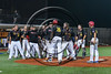 Syracuse Spartans players congratulate Micah Riddick (26) on his home run against the Cortland Crush at OCC Turf Field in Syracuse, New York on Monday, July 24, 2017. Syracuse won 3-2 in 10 innings.