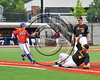 Syracuse Spartans Thomas Horstkotte (40) slides into First Base for an out against Cortland Crush Joseph Rogers (9) at OCC Turf Field in Syracuse, New York on Monday, July 24, 2017. Syracuse won 3-2 in 10 innings.