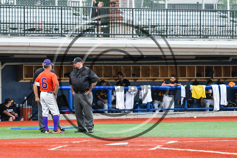 Cortland Crush Manager Bill McConnell talks with the Umpires before the game against the Syracuse Spartans at OCC Turf Field in Syracuse, New York on Monday, July 24, 2017