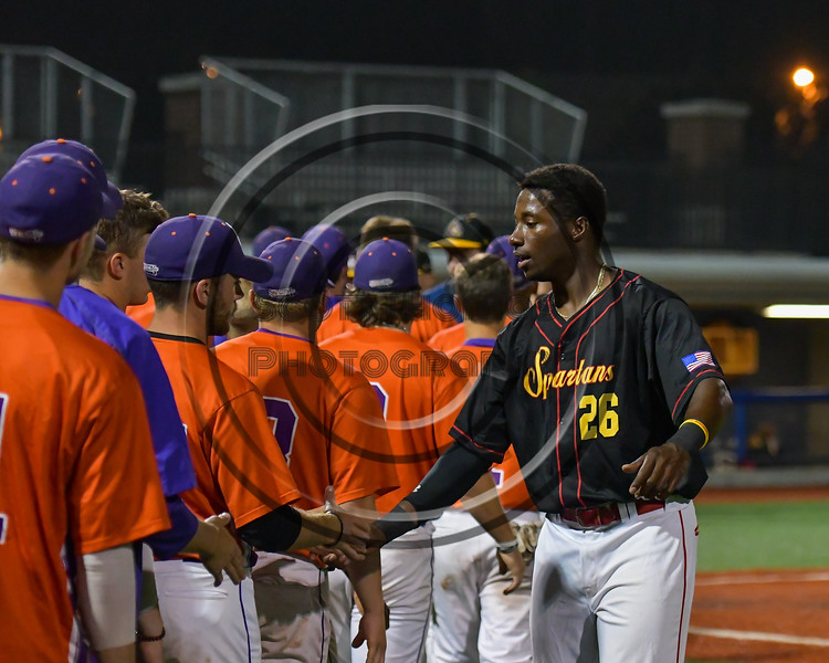 Syracuse Spartans Micah Riddick (26) shakes hands with Cortland Crush players after a game at OCC Turf Field in Syracuse, New York on Monday, July 24, 2017. Syracuse won 3-2 in 10 innings.