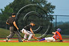 Cortland Crush Josh Reuter (23) is tagged out at Third Base against the Syracuse Spartans at OCC Turf Field in Syracuse, New York on Monday, July 24, 2017. Syracuse won 3-2 in 10 innings.