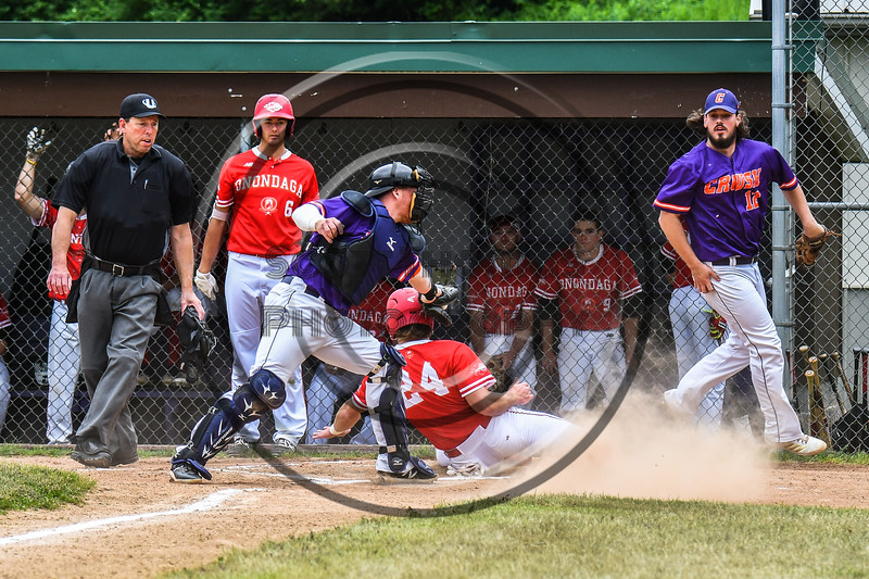 Cortland Crush Hayden Houts (5) tags Onondaga Flames Jarrad Grossguth (24) out at Home on Greg's Field at Beaudry Park in Cortland, New York on Sunday, June 3, 2018. Cortland won 7-5.