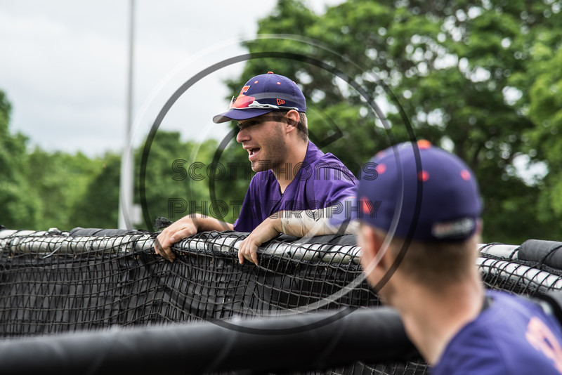 Cortland Crush Nick Palma (27) catching a ride on the batting cage on Greg's Field at Beaudry Park in Cortland, New York on Sunday, June 3, 2018.
