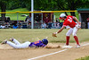 Cortland Crush Alex Babcock (16) slides safe into 3rd Base against Onondaga Flames Jarrad Grossguth (24) on Greg's Field at Beaudry Park in Cortland, New York on Sunday, June 3, 2018. Cortland won 7-5.