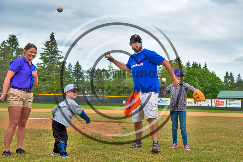 Cortland Crush fans throwing the First Pitch before a game on Greg's Field at Beaudry Park in Cortland, New York on Sunday, June 3, 2018.