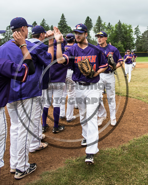 Cortland Crush players celebrating their win over the Onondaga Flames on Greg's Field at Beaudry Park in Cortland, New York on Sunday, June 3, 2018. Cortland won 7-5.