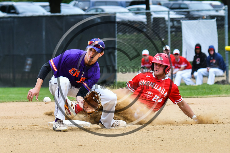 Onondaga Flames Jarrad Grossguth (24) slides safe into 2nd Base before Cortland Crush Jimmy Tatum (17) gets the ball on Greg's Field at Beaudry Park in Cortland, New York on Sunday, June 3, 2018. Cortland won 7-5.