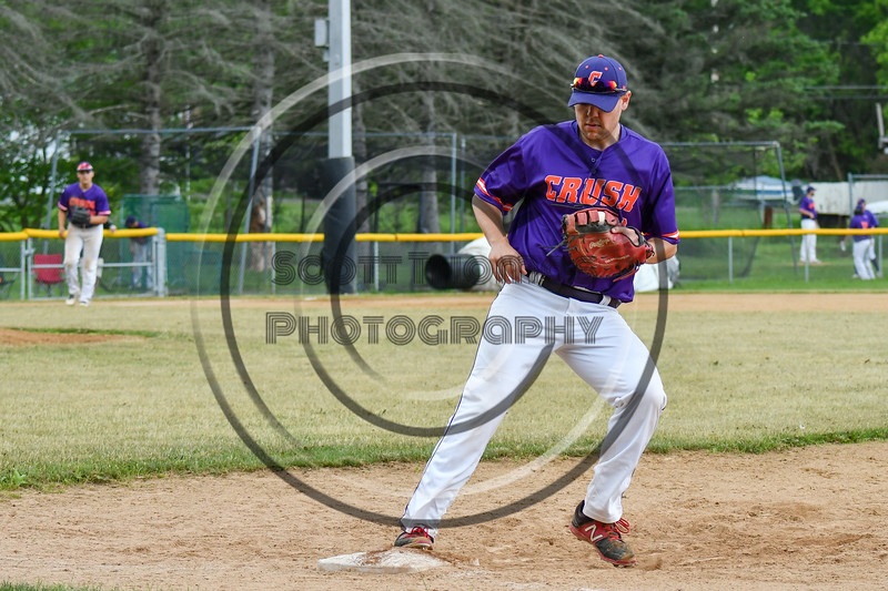 Cortland Crush 1st Baseman Zach Kelley (33) forces the Onondaga Flames runner out on Greg's Field at Beaudry Park in Cortland, New York on Sunday, June 3, 2018. Cortland won 7-5.