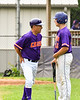 Cortland Crush Head Coach Bill McConnell (6) talks with Alex Babcock (16) before he bats against the Onondaga Flames on Greg's Field at Beaudry Park in Cortland, New York on Sunday, June 3, 2018. Cortland won 7-5.