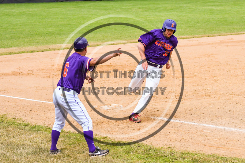 Cortland Crush 3rd Base Coach Bill McConnell waves Zach Kelley (33) in for a score against the Onondaga Flames on Greg's Field at Beaudry Park in Cortland, New York on Sunday, June 3, 2018. Cortland won 7-5.