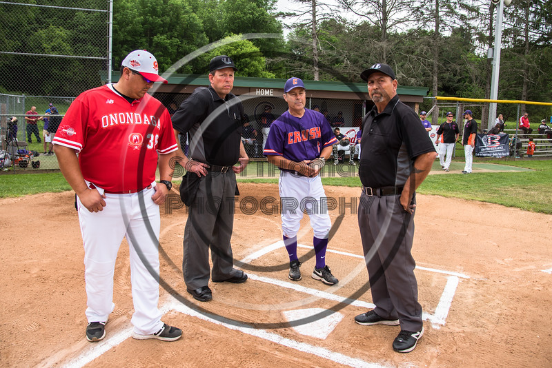 Cortland Crush Head Coach Bill McConnell, Onondaga Flames Head Coach Michael Cordero and the Umpires go over field rules before a game on Greg's Field at Beaudry Park in Cortland, New York on Sunday, June 3, 2018.
