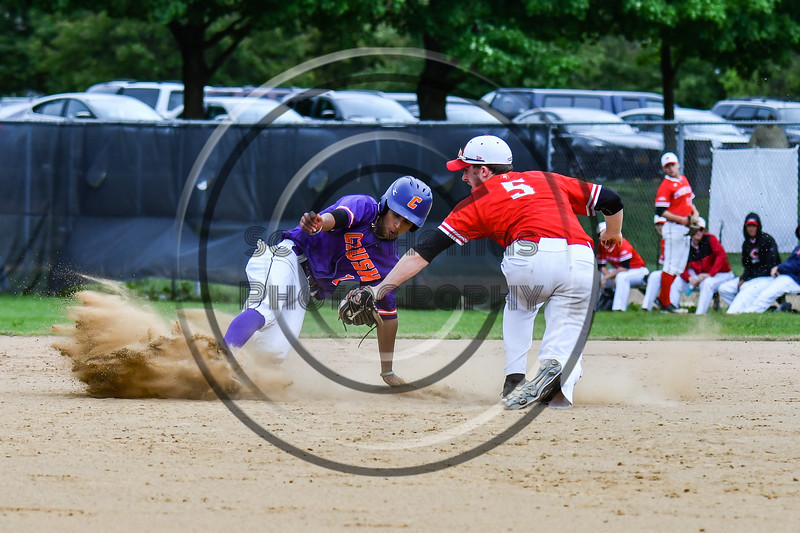 Cortland Crush Iset Maldonado (1) avoids a tag by Onondaga Flames Bryan Hart (5) and is safe on 2nd base on Greg's Field at Beaudry Park in Cortland, New York on Sunday, June 3, 2018. Cortland won 7-5.