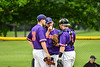 Cortland Crush Zach Kelley (33) and Hayden Houts (5) talk with pitcher Jake Rajsigl (12) during a timeout against the Onondaga Flames on Greg's Field at Beaudry Park in Cortland, New York on Sunday, June 3, 2018. Cortland won 7-5.