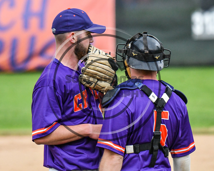 Cortland Crush Catcher Hayden Houts (5) talks with Michael Perreault (8) during a timeout against the Onondaga Flames on Greg's Field at Beaudry Park in Cortland, New York on Sunday, June 3, 2018. Cortland won 7-5.