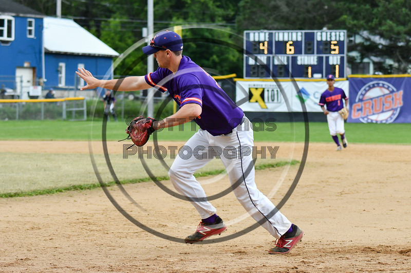 Cortland Crush 1st Baseman Zach Kelley (33) fields the ball against the Onondaga Flames on Greg's Field at Beaudry Park in Cortland, New York on Sunday, June 3, 2018. Cortland won 7-5.