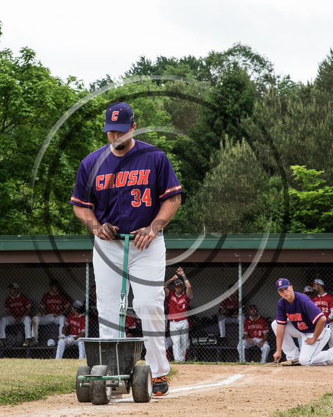 Cortland Crush Brenden Clanton (34) lining the 3rd Base line before playing the Onondaga Flames on Greg's Field at Beaudry Park in Cortland, New York on Sunday, June 3, 2018.