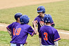 Cortland Crush players Jonathan Triesler (19) and Anthony Cieszko (3) congratulate Jimmy Tatum (17) on his hit against the Onondaga Flames on Greg's Field at Beaudry Park in Cortland, New York on Sunday, June 3, 2018. Cortland won 7-5.