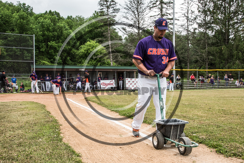 Cortland Crush Brenden Clanton (34) lining the 1st Base line before playing the Onondaga Flames on Greg's Field at Beaudry Park in Cortland, New York on Sunday, June 3, 2018.