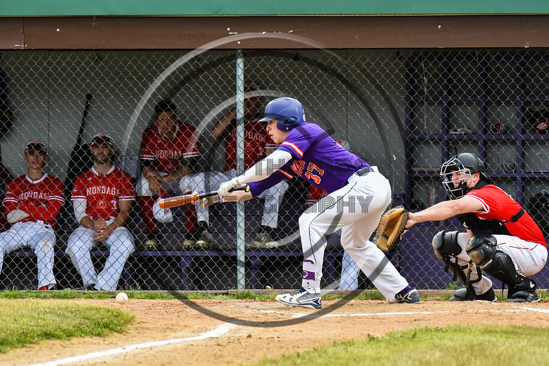 Cortland Crush John Volpe (37) bunts the ball allowing a run to score against the Onondaga Flames on Greg's Field at Beaudry Park in Cortland, New York on Sunday, June 3, 2018. Cortland won 7-5.