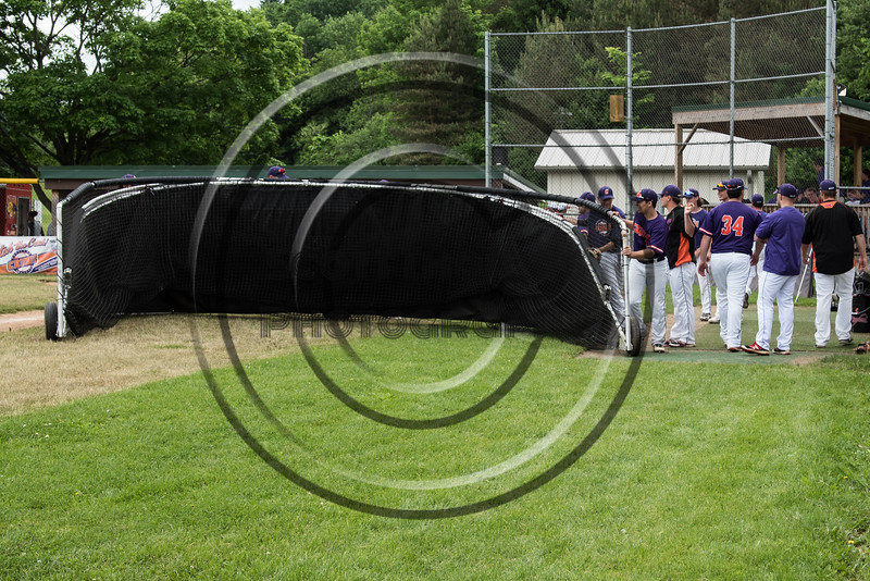 Cortland Crush players putting the batting cage away after batting practice on Greg's Field at Beaudry Park in Cortland, New York on Sunday, June 3, 2018.