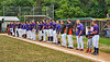Cortland Crush players and coaches stand along the 3rd Base line for the National Anthem befreo playing the Onondaga Flames on Greg's Field at Beaudry Park in Cortland, New York on Sunday, June 3, 2018.