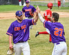 Cortland Crush Nick Palma (27) gives Michael Perreault (8) a high five after an inning against the Onondaga Flames on Greg's Field at Beaudry Park in Cortland, New York on Sunday, June 3, 2018. Cortland won 7-5.