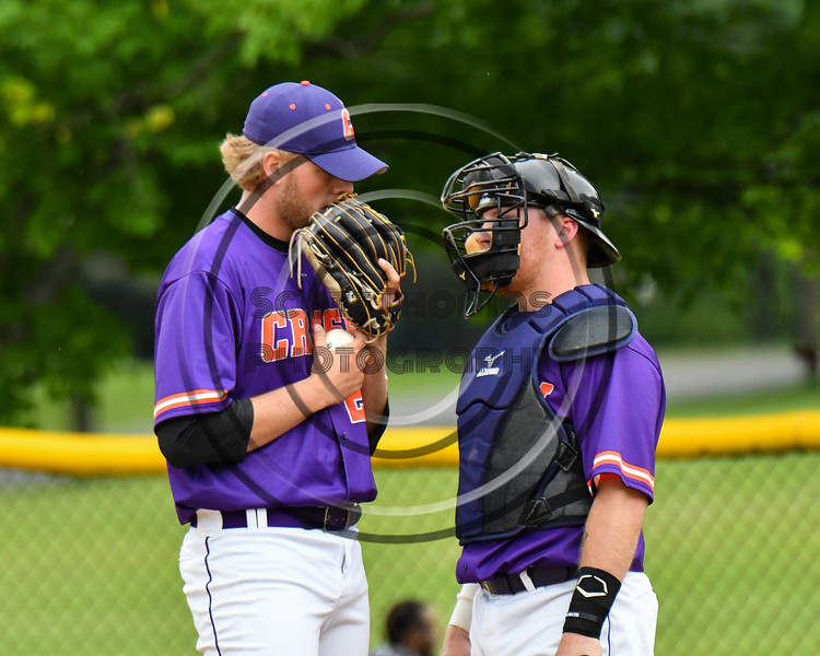 Cortland Crush Catcher Hayden Houts (5) talks with pitcher Alex Larson (26) against the Onondaga Flames on Greg's Field at Beaudry Park in Cortland, New York on Sunday, June 3, 2018. Cortland won 7-5.