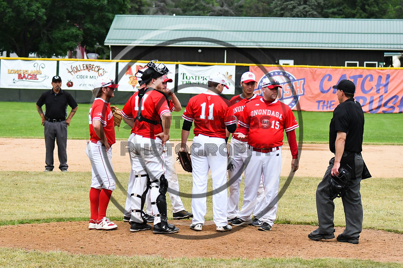 Umpire asks the Onondaga Flames coach to make a decision on his next pitcher against the Cortland Crush on Greg's Field at Beaudry Park in Cortland, New York on Sunday, June 3, 2018. Cortland won 7-5.