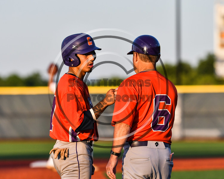 Cortland Crush Head Coach Bill McConnell (6) gives a fist bump to xxx (x) for reaching 3rd Base against the Onondaga Flames at OCC Turf Field in Syracuse, New York on Friday, June 8, 2018. Cortland won 6-4.