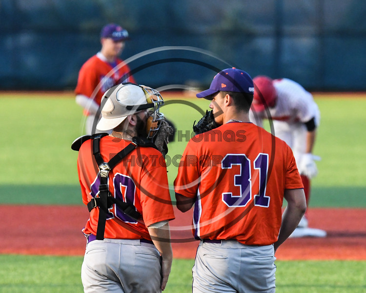 Cortland Crush catcher Garrett Hunter (40) confers with pitcher Jordan Christian (31) during a timeout against the Onondaga Flames at OCC Turf Field in Syracuse, New York on Friday, June 8, 2018. Cortland won 6-4.