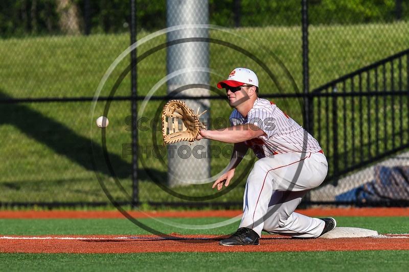 Onondaga Flames Trace Peterson (17) stretching out for a force out at 1st Base against the Cortland Crush at OCC Turf Field in Syracuse, New York on Friday, June 8, 2018. Cortland won 6-4.