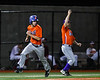 Cortland Crush Head Coach Bill McConnell (6) waves in Dylan Ketch (14) to Home against the Onondaga Flames at OCC Turf Field in Syracuse, New York on Friday, June 8, 2018. Cortland won 6-4.
