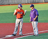 Cortland Crush Garrett Hunter (40) talks with Assistant and 1st Base Coach Connor Griffin during a game against the Onondaga Flames at OCC Turf Field in Syracuse, New York on Friday, June 8, 2018. Cortland won 6-4.