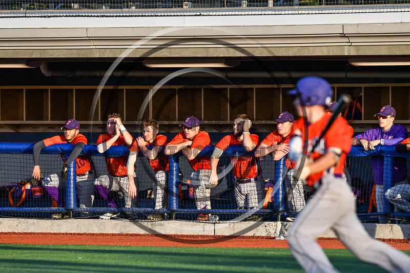 Cortland Crush players watch from the dugout as Anthony Cieszko (3) gets a hit against the Onondaga Flames at OCC Turf Field in Syracuse, New York on Friday, June 8, 2018. Cortland won 6-4.
