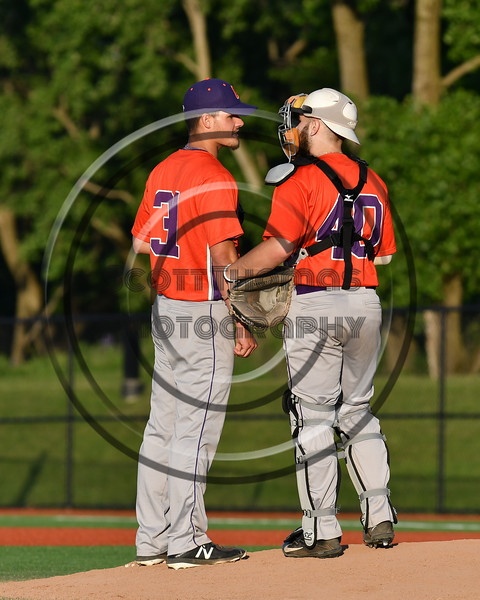 Cortland Crush catcher Garrett Hunter (40) conferences with pitcher Jordan Christian (31) on the mound during a game against the Onondaga Flames at OCC Turf Field in Syracuse, New York on Friday, June 8, 2018. Cortland won 6-4.