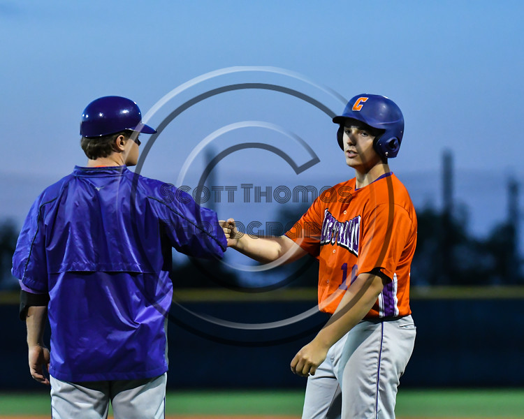 Cortland Crush Assistant and 1st Base Coach Connor Griffin gives a fist bump to Alex Babcock (16) upon reaching 1st Base and bringing in a run against the Onondaga Flames at OCC Turf Field in Syracuse, New York on Friday, June 8, 2018. Cortland won 6-4.