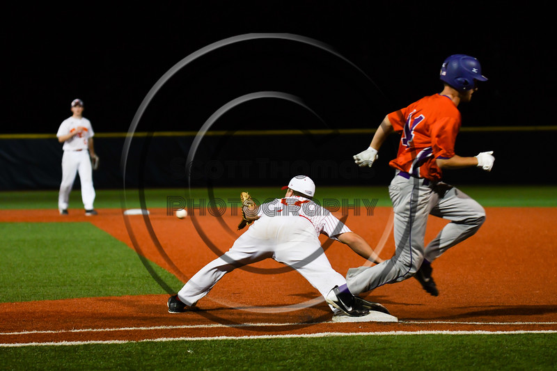 Cortland Crush Dylan Ketch (14) beats the throw to 1st Base against the Onondaga Flames at OCC Turf Field in Syracuse, New York on Friday, June 8, 2018. Cortland won 6-4.