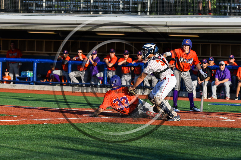 Cortland Crush Zach Kelley (33) is tagged out at Home Plate by Onondaga Flames catcher Gunnar Groen (31) at OCC Turf Field in Syracuse, New York on Friday, June 8, 2018. Cortland won 6-4.