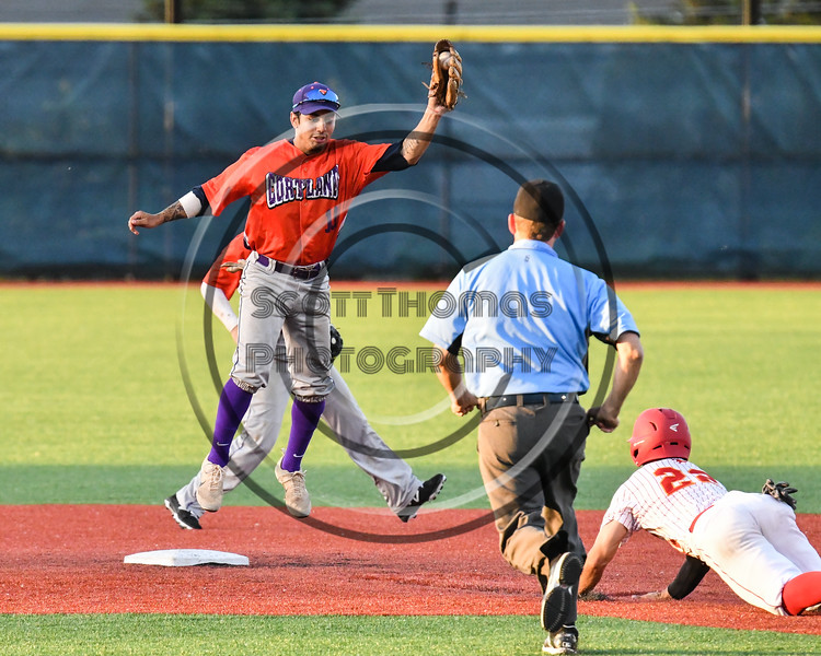 Cortland Crush Julio Creazzola (11) catches the throw to 2nd Base and tagged Onondaga Flames Adam Gordon (22) out at OCC Turf Field in Syracuse, New York on Fridday, June 8, 2018. Cortland won 6-4.