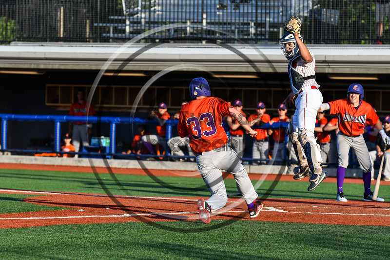 Cortland Crush Zach Kelley (33) heading to Home Plate against Onondaga Flames catcher Gunnar Groen (31) at OCC Turf Field in Syracuse, New York on Friday, June 8, 2018. Cortland won 6-4.