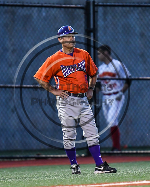 Cortland Crush Head Coach Bill McConnell (6) coaching at 3rd Base against the Onondaga Flames at OCC Turf Field in Syracuse, New York on Friday, June 8, 2018. Cortland won 6-4.