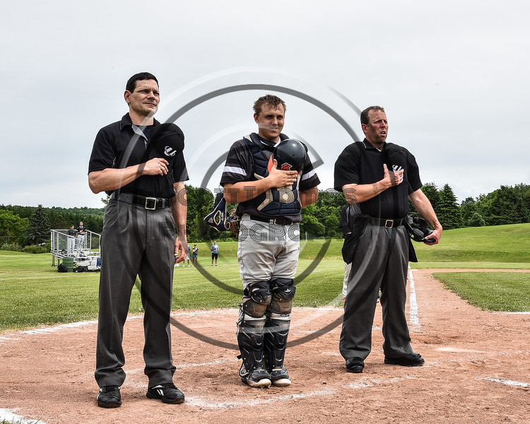 Sherrill Silversmiths Matthew Fitzgerald (7) standing with the Umpires during the National Anthem before playing the Cortland Crush at the LaFayette Junior and Senior High School Field in LaFayette, New York on Saturday, June 9, 2018.