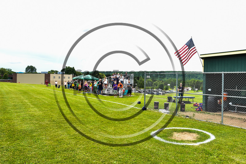 Fans and family of the Cortland Crush and Sherrill Silversmiths stand for the National Anthem at the LaFayette Junior and Senior High School Field in LaFayette, New York on Saturday, June 9, 2018.