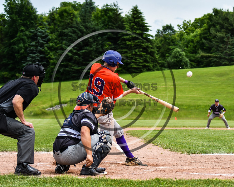 Cortland Crush Jonathan Triesler (19) hits the ball against the Sherrill Silversmiths at the LaFayette Junior and Senior High School Field in LaFayette, New York on Saturday, June 9, 2018. Cortland won 12-6.
