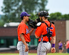 Cortland Crush pitcher Justin Pacheco (4) talks with catcher Justin Valentino (15) during a timeout against the Sherrill Silversmiths at the LaFayette Junior and Senior High School Field in LaFayette, New York on Saturday, June 9, 2018. Cortland won 12-6.