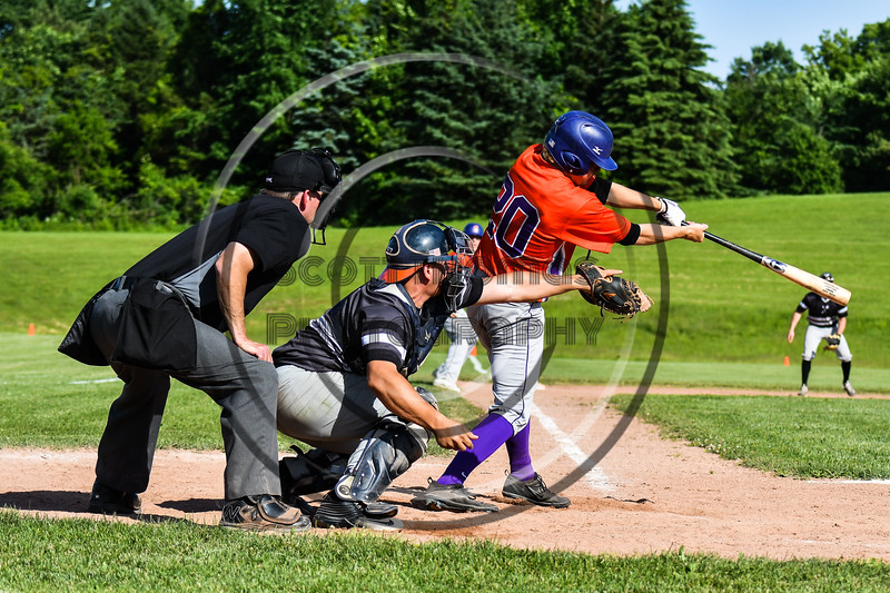 Cortland Crush Charlie Hammell (20) punches the ball for a hit against the Sherrill Silversmiths at the LaFayette Junior and Senior High School Field in LaFayette, New York on Saturday, June 9, 2018. Cortland won 12-6.